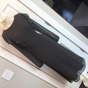 Mid-length black and white polka dot dress